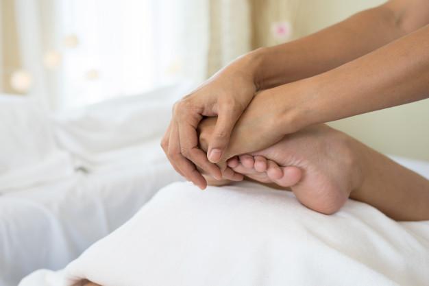 close-up-of-woman-doing-foot-massage-at-spa_1150-3100