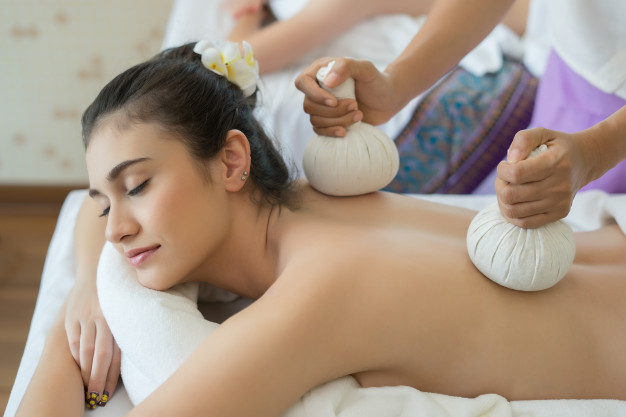 young-beautiful-woman-relaxing-during-massage-in-spa-salon_1150-3082
